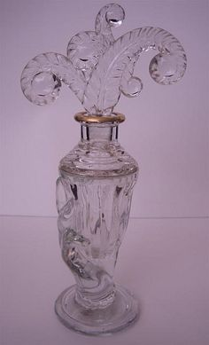 Crystal Glass Perfume Bottle with elaborate Glass Stopper  (feathers/ferns) and a Gold Gilt Neck/Rim | by 'Iron Lace' via flickr  ♥•♥•♥
