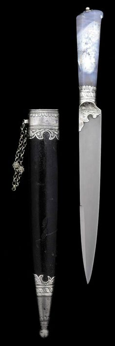 A FINE RUSSIAN SILVER-MOUNTED AGATE HANDLED DAGGER   18TH CENTURY   With tapering single-edged spear-point blade with short false back-edge, the base of the hilt and forte encased within a silver collar engraved with scrollwork, decorative bands and foliage, characteristic faceted agate hilt with small engraved silver flower and button encasing the tang, in original black-leather-covered sheath with silver locket and chape engraved en suite with the collar