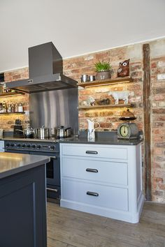 The Main Company designed this bespoke kitchen to blend seamlessly with the rest of this Yorkshire property using reclaimed oak wood and painted cabinets. Claire's Kitchen, Kitchen Cooker, Cosy Kitchen, Farmhouse Kitchen Lighting, Farmhouse Kitchen Island, Modern Farmhouse Kitchens, Home Kitchens, Kitchen Decor, Kitchen Diner Extension