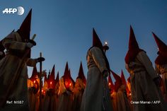 "Penitents from the ""Real Hermandad del Santisimo Cristo de las Injurias"" brotherhood parade during the ""El Silencio"" procession marking Holy Week in the northwestern Spanish city of Zamora on April..."
