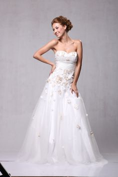 I like the idea of adding a little applique, maybe leaves instead of flowers, and not as thickly as on this dress.