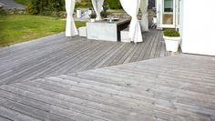 Designing a wood deck can be done very simply with great results, but consider how a modern style combined with a bit of creativity can turn an otherwise plain deck space into something more useful as well as eye-catching. Here are a few modern wood deck ideas to inspire you to create an impressive outdoor zone.