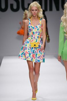 GARMENT INTERPRETATION 2:  Moschino spring 2015 Ready-To-Wear collection, the fact that its a skirt and top with the same print makes it very soft pop, by adding the camera as part of an accessory makes the look fun and entertaining.  Source Link: http://www.style.com/slideshows/fashion-shows/spring-2015-ready-to-wear/moschino/collection/14