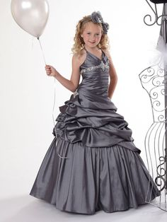 Love the tiers!  So classic!    You don't need a high glitz pageant dress to look amazing! The Tiffany Princess pageant gown 13287 is a halter style natural pageant gown that features a v neckline with beaded accent at the empire waist, and a pleated bodice with taffeta pick up skirt. Pair this with Little Miss pageant shoes for little girls so she can be confident in her winning look!