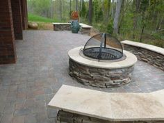 StoneFire Pit with cover on paver patio in Charlotte, NC