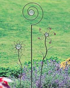 Funky garden flowers, looks like they are made from welding rods.