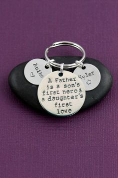 Daughter's First Love, Son's First Hero Keychain - DII - Dad Gift - Father's Day - Custom Keepsake - Personalized Gift - Fast 1 Day Shipping. Father's Day Gift - dad keychain with handstamped quote, personalized with childrens names of your choice by DistinctlyIvy. ------------------------------------------- PRODUCTION TIME Ships in 1 Business Day! ------------------------------------------- PRODUCT FAQs Purchase of this item comes with 1 inch silver handstamped disc, 5/8 inch silver...