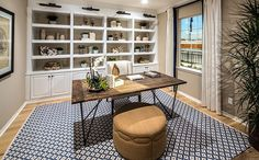 Optional rooms, including a loft and home office, create flexible spaces for work or play. - Residence 3 at Hampshire at College Park in Chino, CA New Homes For Sale, Real Estate Marketing, Hampshire, Home Office, Building A House, Entryway Tables, Loft, Shelves, Offices