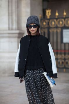 A maxi skirt and sporty varsity jacket make for a unique duo.   - HarpersBAZAAR.com