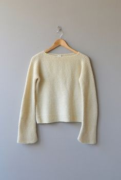 Vintage hand knit alpaca sweater with bateau neckline and long bell sleeves.  --- M E A S U R E M E N T S ---  fits like: medium bust: up to 40 waist: