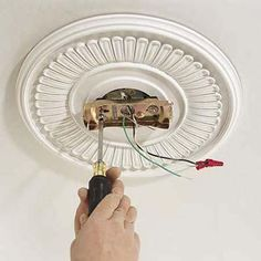 Installing a ceiling fan is relatively simple, especially if the space above is accessible from an attic. Read this step-by-step guide to putting in a versatile and stylish fixture. Home Ceiling, Ceiling Lights, Painting Ceiling Fans, Ceiling Fan Installation, Ceiling Fan Makeover, Old Lights, Diy Fan, Outdoor Ceiling Fans, Ceiling Medallions