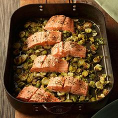 Garlic Roasted Salmon & Brussels Sprouts Roasting salmon on top of Brussels sprouts and garlic, flavored with wine and fresh oregano, is simple enough for a weeknight meal yet sophisticated enough to serve to company. Serve with whole-wheat couscous. Salmon Recipes, Fish Recipes, Seafood Recipes, Dinner Recipes, Healthy Recipes, Dinner Ideas, Juice Recipes, Clean Recipes, Seafood