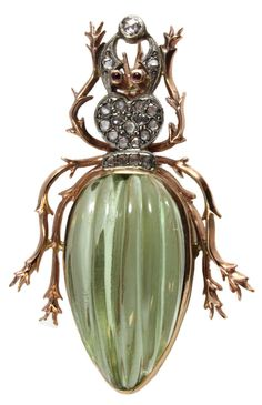 Fabergé. Rose gold Beetle Brooch. It has 19 white diamonds, two rubies set as eyes and large green citrine set as abdomen. Early 20th century, Russia.