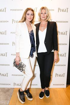 Olivia Palermo and Alexandra Richards share a moment in front of the Piaget Possession photocall on May 25, 2016