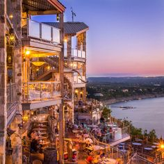 The Oasis on Lake Travis, Austin, Texas — by MapNomads. Oasis in Austin is a place famous for its sunset views. They even ring a bell when the sun sets in the horizon,...