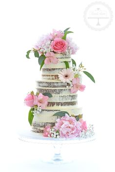 A beautiful semi-naked wedding cake with fresh flowers