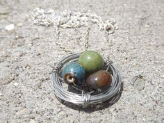 Bird's nest necklace- blue, green, and brown beads & stones