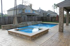 """Geometric rectangular pool with vanishing edge or known also as infinity edge spa 1""""x1"""" glass tiles diamondbrite - Super Blue - Raised wall with ledger stone - sheer descents - Concrete cantilever edge, stamped concrete - Texas Aquatics & Pool Services - Houston, Texas and surrounding areas 281-852-5630 www.thetexasaquatics.com North Houston, Humble, The Woodlands, Kingwood, Conroe, Spring, Porter, Huffman"""