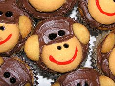 Monkey Cupcakes--All you need to make the monkey face is a chocolate frosted cupcake, 3/4 regular vanilla wafer, two halves of a mini vanilla wafer, and some black and red icing gel for the eyes, nostrils and mouth.
