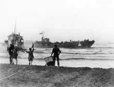 Operation Husky: The Sicily Landings 9-10 July 1943: Instructions being signalled to waiting landing craft by semaphore at dawn of the opening day of the invasion of Sicily. One is LCI (L) 124 the other is an unidentified LCT.