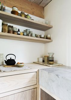 light wood cabinets and open shelving with marble in this modern scandinavian style kitchen | via coco+kelley