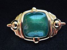 Vintage Monet Brooch. Gold Tone with Green Enamel Center Feature, Excellent Condition. Signed  Ask a Question $14.00 USD