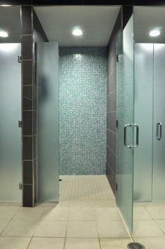 Classic fitness center showers with frosted glass doors and tile surround. Classic fitness center showers with frosted glass doors and tile surround. Locker Room Shower, Shower Cubicles, Frosted Glass Door, Glass Doors, Gym Showers, Glass Showers, Dance Studio Design, Gym Interior, Changing Room