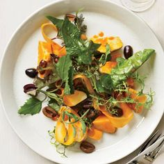 Seamus Mullen slowly poaches chicken in a broth made with chicken stock, white wine, and vegetables. He tosses the meat with salad greens, fingerling potatoes, carrot ribbons, and Spanish Arbequina o...see more
