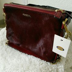 Fossil Memoir Cranberry Pocketbook Top Zip Brand New Absolutely Beautiful Double Zip Bag with ample space for daily necessities. Made with actual calf hair in beautiful cranberry color. Comes with Dust bag and care card. Fossil Bags Clutches & Wristlets
