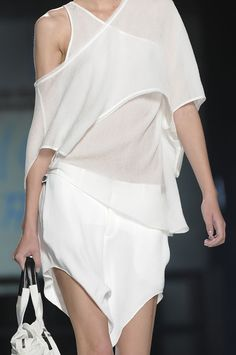 Helmut Lang, Spring 2012; the use of layering within this ensemble is extremely successful, the designer has created interest within the use of a sigle colour by overlaying a variety of textured and sheer fabrics. image via-sweetstroll.tumblr.com/