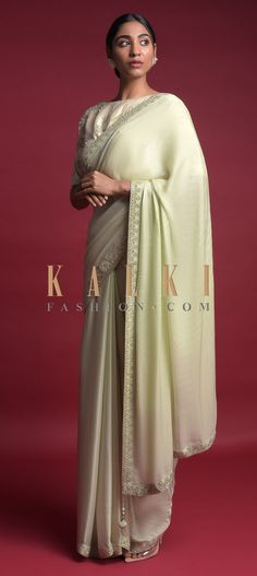 Buy Online from the link below. We ship worldwide (Free Shipping over US$100)  Click Anywhere to Tag Tea Green Saree In Chiffon Blend With Cut Dana Work On The Border Online - Kalki Fashion Tea green saree in chiffon blend adorned with cut dana work in the border.Paired with a beige blouse in silk with cut dana and sequins embroidered floral pattern.Designed with round neckline and half sleeves.