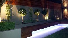 Modern garden design ideas great lighting fireplace hardwood screen plastered rendered walls clapham battersea  south west london LED strip lights landscaping