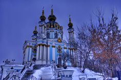 This evening while walking to dinner at an Uzbekistan restaurant, the sun started to go down behind the icy overcast skies, casting more of that eerie blue light across the city of Kiev. There were a few flecks of snow beginning to fall, but not enough to obscure Saint Andrews Church here as we passed. - Kiev, Ukraine - Photo from #treyratcliff Trey Ratcliff at http://www.StuckInCustoms.com