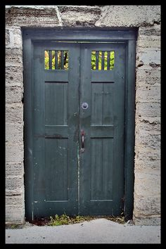 love the color and windows on this old door.