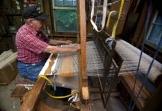 Fred Parnell of Tyro works as his antique loom and makes and old style rag rug. Parnell sells his heritage craft around the the area including the farmer's market in Salisbury, NC