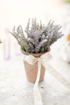 Plant pots filled with fresh lavender will not only look lovely for centerpieces but can also be given as favors. #centerpieces #frenchcountry
