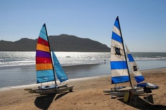 Catamarans on the beach in Mazatlan, Mexico...took to Deer Island