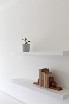 View the full picture gallery of Carnide Apartment Minimal Kitchen, Neutral Walls, Apartment Renovation, Minimalist Apartment, Drawer Unit, Mid Century Chair, Bespoke Furniture, Decorative Accessories, Ideas