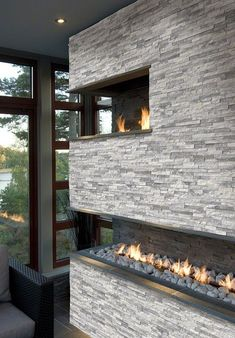 Stacked Stone Ledger panels are trimmed pieces of natural stone affixed together to form modular stone veneer panels which allows for the streamlined installation of a dry stacking stone veneer. Fireplace Wall, Fireplace Design, Fireplace Ideas, Grey Stone Fireplace, Double Fireplace, Ledger Stone Fireplace, Fireplace Gallery, Modern Fireplace, Marble Wall