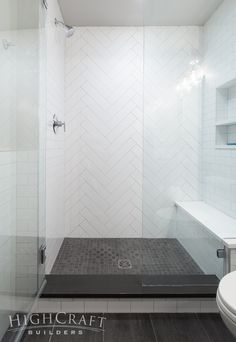 And white subway tiles create a herringbone accent wall in the shower. This Fort Collins basement remodel is full of modern and rustic finishes, unique lighting, open shelving, striking accent walls and personality galore. White Subway Tile Bathroom, Subway Tile Showers, Modern Bathroom, Small Bathroom, Subway Tiles, Bathroom Ideas, Master Bathrooms, Herringbone Subway Tile, White Tile Shower