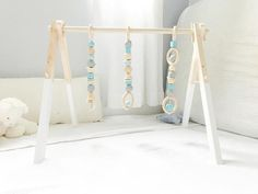 Could it be? A functional, modern baby gym stylish enough for your living room. Designed to provide a feeling for the aesthetics of shape and color, our wooden