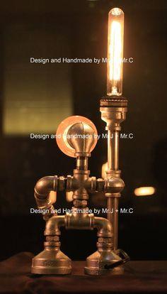 Items similar to EBE Designer Industrial Lighting - Steampunk Lamp Table Lamp Edison Vintage Light Water Pipe Bedside Lamp Rustic Light on Etsy Steampunk Boy, Steampunk Lamp, Industrial Pipe, Industrial Lighting, Men Cave, Lamp Table, Pipe Lamp, How To Make Light, Light Fittings