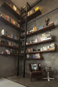 Large library with walnut shelves  custom-built by woodworker Tom Clossey.