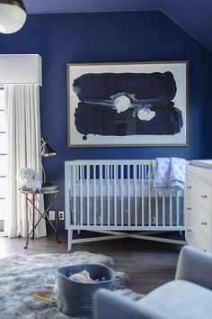 This Nursery Is Out Of World With Cosmic Cool Blues And Clean White Furniture