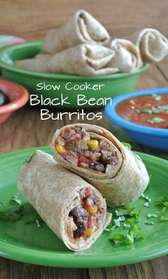 Slow Cooker Black Bean Burritos are easy and spicy with lots of texture. It all turns into a hearty meal .Add avocados and black olives too. via @VeganFreezer