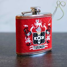 Order your own Custom Family Crest Needlepoint Flask for that one-of-a-kind gift idea.  Our Flasks are 4 inches wide x 4.5 inches high x 1.25 inches deep.  The flask cover is needlepointed by hand and made-to-order. You can personalize any of our designs. We use 100% genuine leather for the trim and a 5 oz stainless steel flask. Each flask includes a FREE monogram. Needlepoint Kits, Needlepoint Canvases, Free Monogram, Family Crest, Customized Gifts, Flasks, Blog, Fun, Stitching