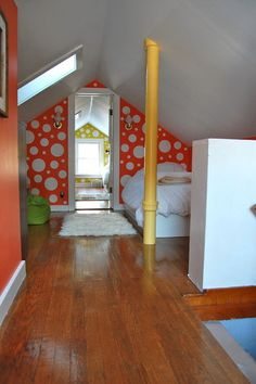 "attic bedroom: take advantage of pipes and necessary ""eye sores"" by turning them into accents (cf. yellow pipe)"
