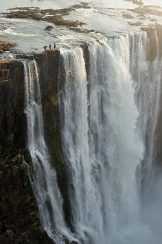"""devilsorangels:  horriblyhorrible: LOOK AT THESE 3 PEOPLE AT THE EDGE OF THE WATERFALL THEY'RE JUST STANDING THERE LIKE """"HOLY SHIT THIS IS A..."""