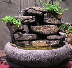 Item Number: SS51 Bowl Style:Large Lotus Bowl Color:Textured Grey Stone Bowl Size: 18in. diameter Approximate Height: 12″ to 14″ (from top of rock to bottom of bowl) This is a cup to cup waterfall fountain. The see troughs are magnificent.