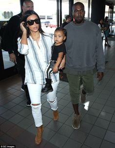 Trendy trio: Kim's husband Kanye West, right, is also in Phoenix, Arizona with the two. Th...